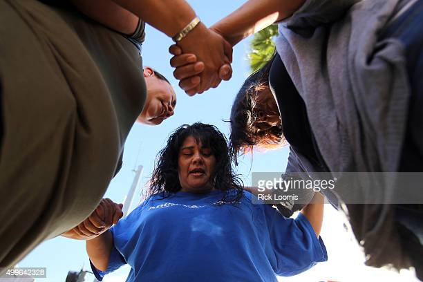 Marie Cabrera Sonya Gonzalez and Christine Duran all of San Bernardino pray after a mass shooting at the Inland Regional Center on December 2 2105 in...