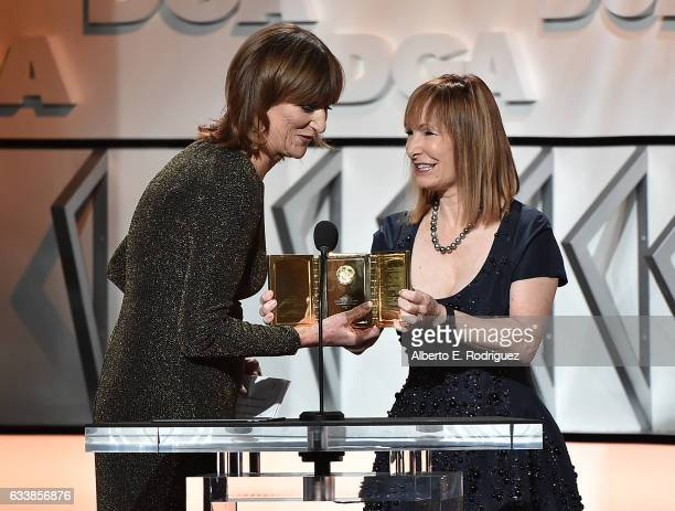 Marie Cantin accepts the Frank Capra Achievement Award from producer Gale Anne Hurd onstage during the 69th Annual Directors Guild of America Awards...