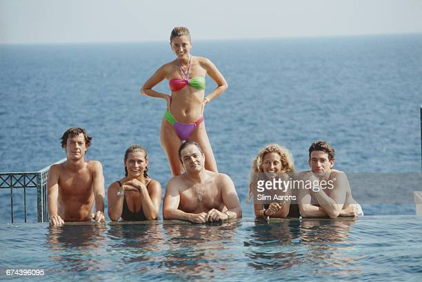 Marie Chantal Miller future wife of Prince Pavlos of Greece lounging with friends at the pool of the Hotel BelAir Cap Ferrat 1991