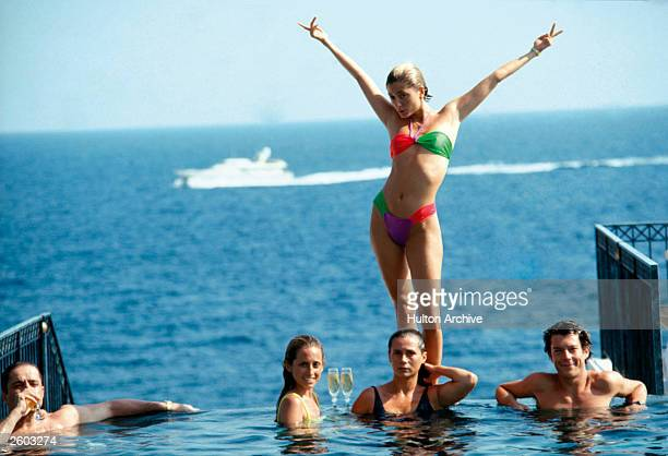 Marie Chantal Miller future wife of Prince Pavlos of Greece strikes an extravagant pose above her sister Pia who is soon to marry Christopher Getty...