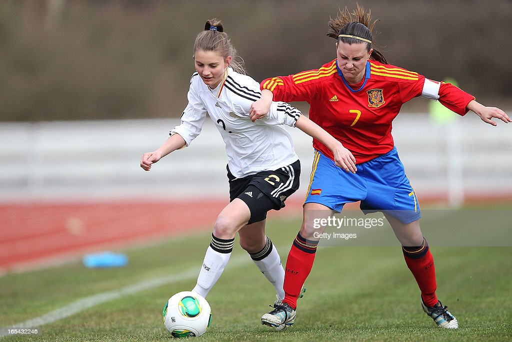 Marie Christin Becker of Germany is challenged by Gema Gili Giner of Spain during the Women's UEFA U19 Euro Qualification match between U19 Germany and U19 Spain at Waldstadion in Viernheim on April 4, 2013 in Viernheim, Germany.