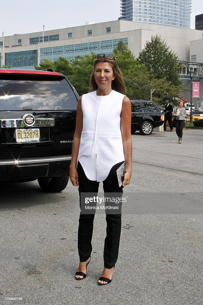 Marie Claire Fashion Director <a gi-track='captionPersonalityLinkClicked' href=/galleries/search?phrase=Nina+Garcia&family=editorial&specificpeople=592222 ng-click='$event.stopPropagation()'>Nina Garcia</a> wearing a Balanciaga top and pants and Stella McCartney shoes and Oliver Peoples sunglasses arrives at the Diesel Black Gold Showing at Pier 94 in Manhattan during Spring 2012 Fashion Week on September 13, 2011 in New York City.