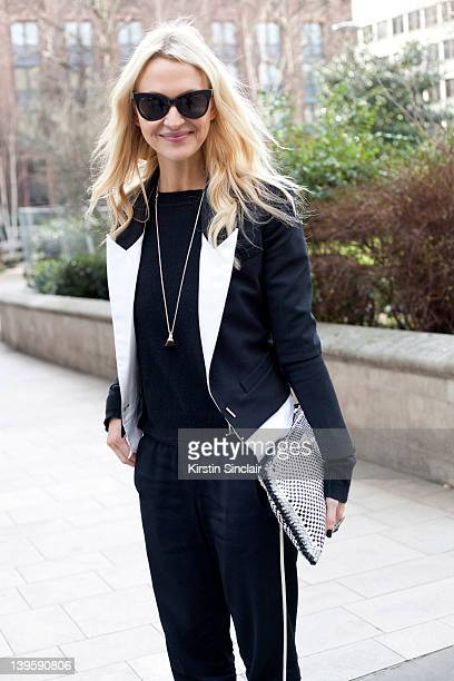 Marie Claire USA Editor Zanna Roberts Rassi wearing Prada clutch French Connection trousers Julien Macdonald jacket White and Warren sweater Norma...