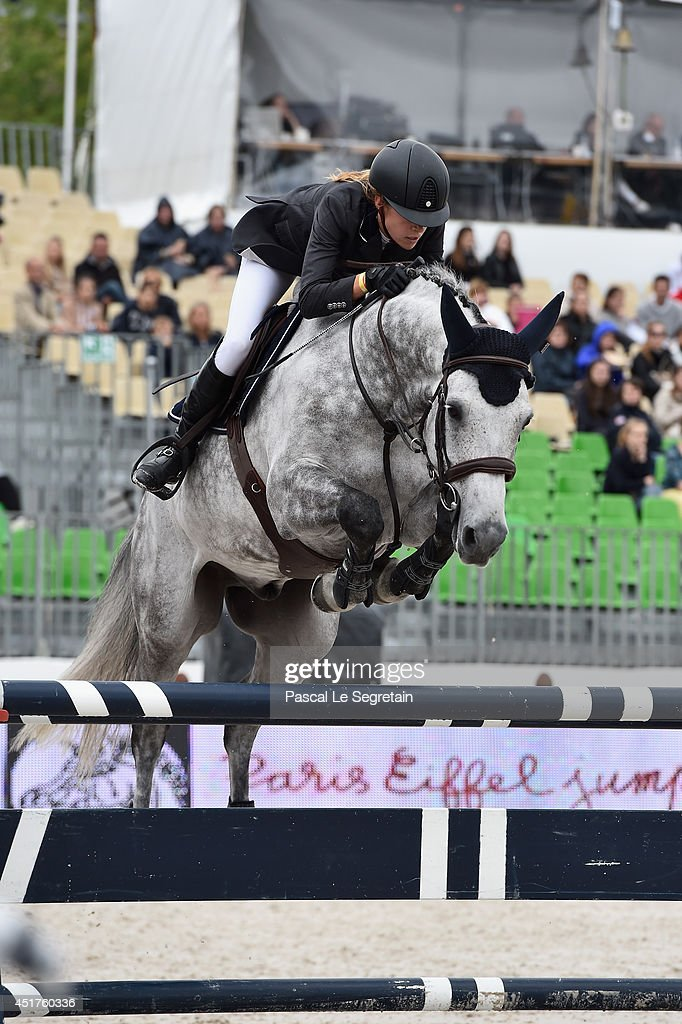 Marie Couperie rides B 'Nl' during the 'Prize Evian Table A against the clock with jump-off' at the Paris Eiffel Jumping presented by Gucci at Champ-de-Mars on July 6, 2014 in Paris, France.