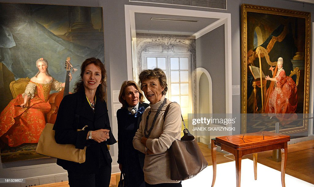 Marie Cristine Labourdette, (L) Director of the Museums of France, Catherine Pegard, president of the public establishment of the National Museum of Versailles and Beatrix Saule (R), Director of the National Museum of Versailles and Trianon attend the opening of an exhibition on Polish princess Marie Leszczynska, who was married to King Louis XV of France during the 18th century, at Warsaw's Royal Castle on September 20, 2013.