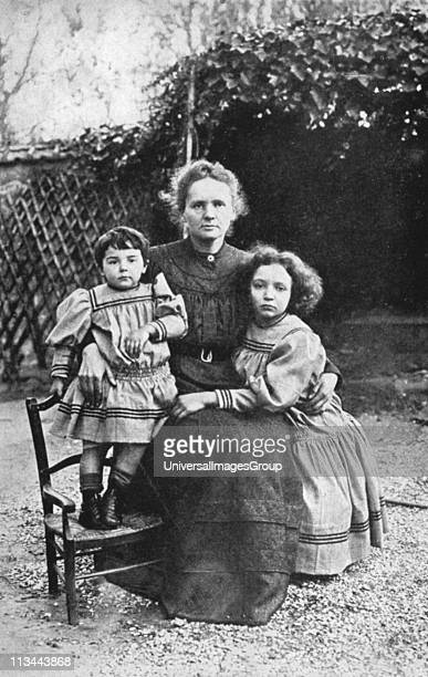 Marie Curie Polishborn French physics with her daughters Eve and Irene in 1908