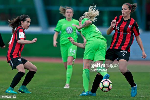 Marie Dølvik of Wolfsburg soffers a fault by Cinta Rodríguez of Sc Huelva when challenging Alicia Redondo of SC Huelva of during the Women's Friendly...