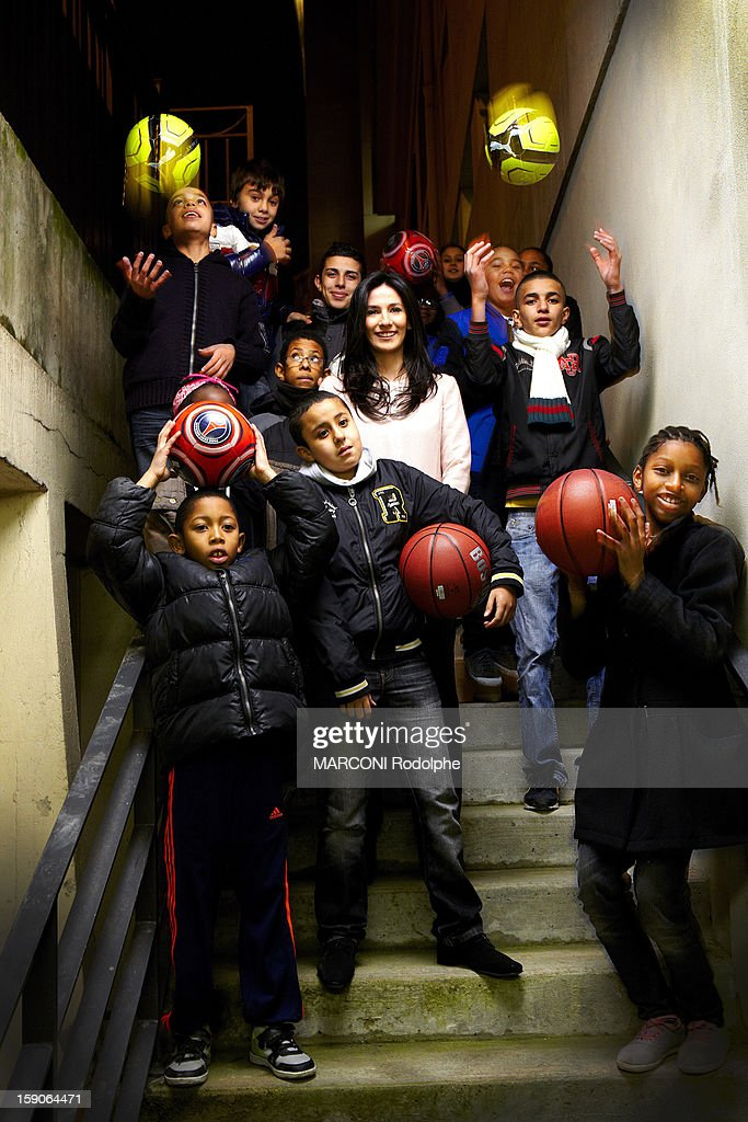 Marie Drucker helps with the association of children practising sport on December 10, 2012, France.