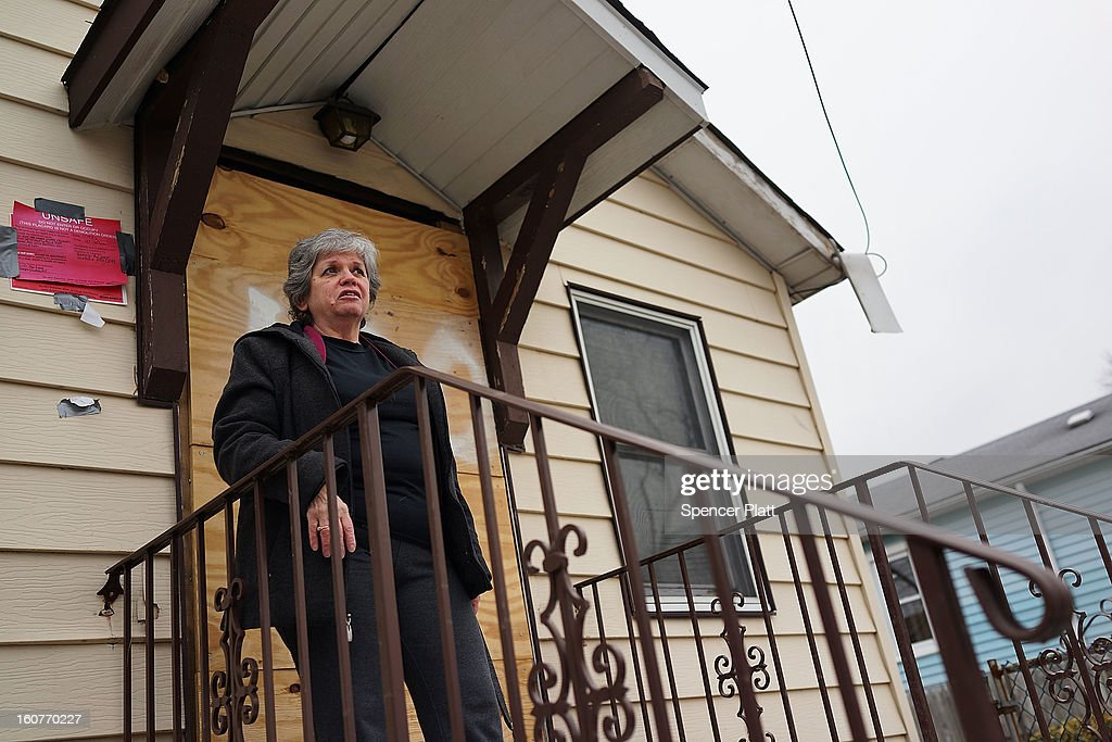 Marie Ecker stands in front of her flood damaged home of 40 years in Oakwood Beach on Staten Island on February 5, 2013 in New York City. In a program proposed by New York Governor Andrew Cuomo, New York state could spend up to $400 million to buy out home owners whose properties were destroyed by Superstorm Sandy. The $50.5 billion disaster relief package, which was passed by Congress last month, would be used to fund the program. If the program is adopted, homeowners would be relocated and their land would be left as a natural barrier to help absorb future floods waters.