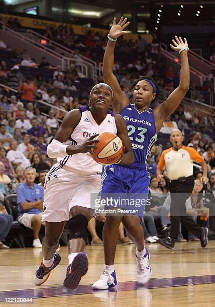 Marie FerdinandHarris of the Phoenix Mercury drives the ball past Cappie Pondexter of the New York Liberty during the WNBA game at US Airways Center...