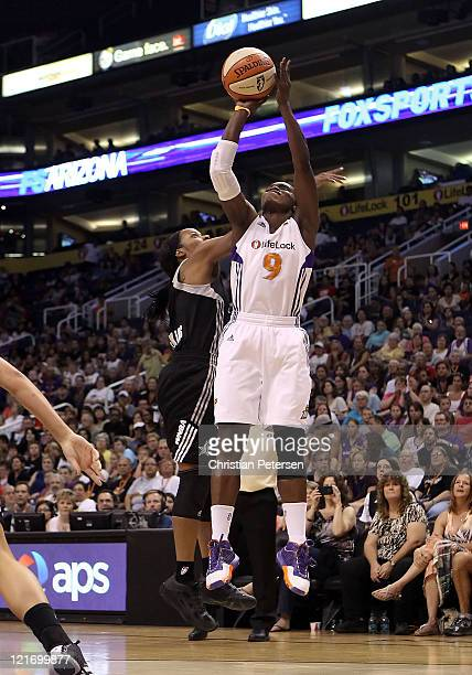 Marie FerdinandHarris of the Phoenix Mercury puts up a shot during the WNBA game against the San Antonio Silver Stars at US Airways Center on August...