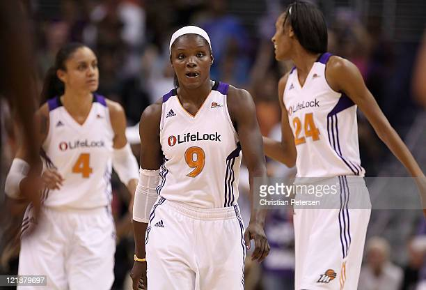 Marie FerdinandHarris of the Phoenix Mercury reacts during the WNBA game against the San Antonio Silver Stars at US Airways Center on August 20 2011...