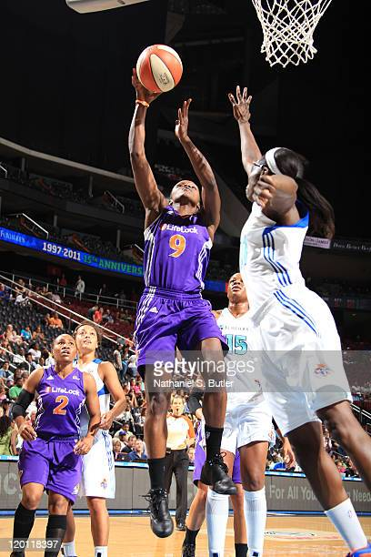 Marie FerdinandHarris of the Phoenix Mercury shoots against Essence Carson of the New York Liberty during a game on July 30 2011 at the Prudential...
