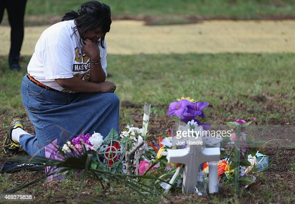 Marie Fogle Hamilton prays as she visits a memorial set up on the site where Walter Scott was killed on April 11 2015 in North Charleston South...