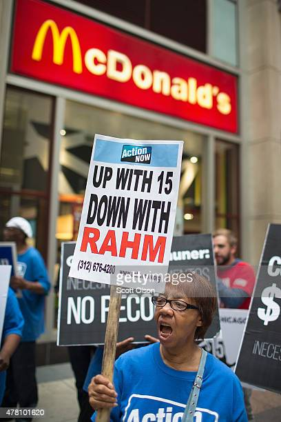Marie Gasaway protests with fast food workers and community activists outside a McDonald's restaurant in the Loop on June 22 2015 in Chicago Illinois...