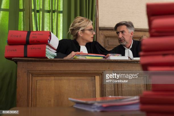 Marie Grimaud and Rodolphe Costantino lawyers of children's safety associations speak together in the courthouse in Le PuyenVelay on October 10 prior...