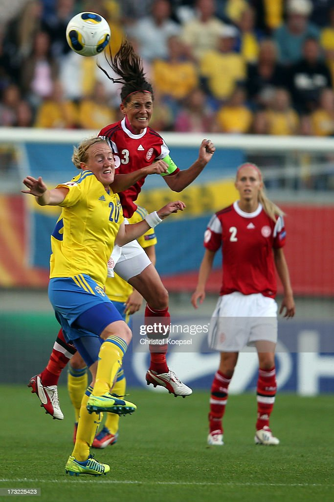 Marie Hammarstroem of Sweden and Katrine Soendergaard Pedersen of Denmark go up for a header during the UEFA Women's EURO 2013 Group A match between Sweden and Denmark at Gamla Ullevi Stadium on July 10, 2013 in Gothenburg, Sweden.
