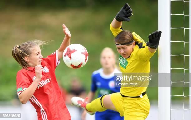 Marie Heinze of 1 FFC Turbine Potsdam saves a header of Anja Suttner of FC Bayern Muenchen during the B Junior Girl's German Championship Final...