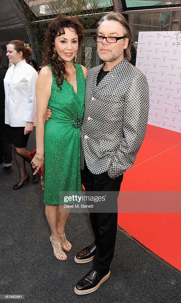 Marie Helvin (L) and David Downton attend Gabrielle's Gala 2013 supported by Lorraine Schwartz at Battersea Power Station on May 2, 2013 in London, England.