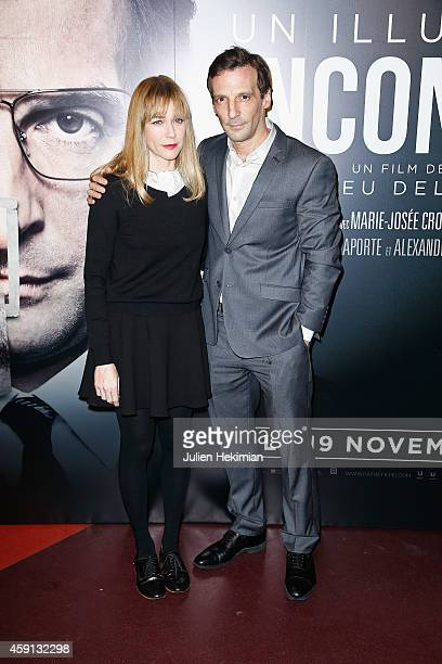 Marie Josee Croze and Mathieu Kassovitz attend 'Un Illustre Inconnu' Paris Premiere at Cinema Gaumont Capucine on November 17 2014 in Paris France