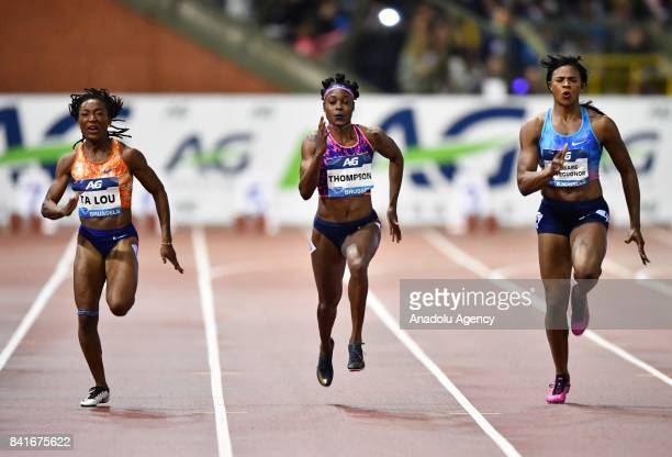 Marie Josee Ta Lou of Ivory Coast Elaine Thompson of Jamaica and Blessing Okagbare of Nigeria compete in the Women's 100 metres during the IAAF...