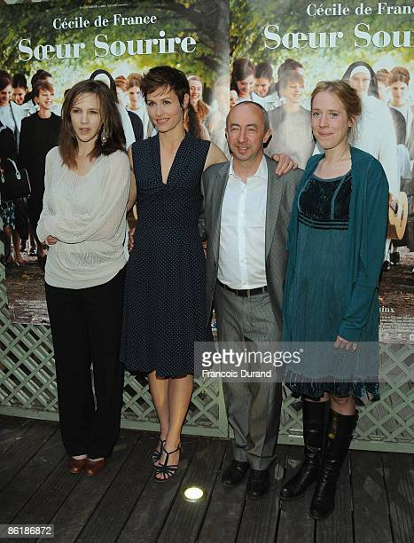 Marie Kremer Cecile de France director Stijn Coninx and Christelle Cornil attend 'Soeur Sourire' Paris Premiere on April 23 2009 in Paris France