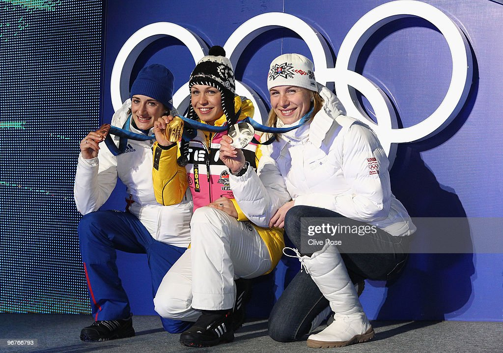 <a gi-track='captionPersonalityLinkClicked' href=/galleries/search?phrase=Marie+Laure+Brunet&family=editorial&specificpeople=4691768 ng-click='$event.stopPropagation()'>Marie Laure Brunet</a> of France celebrates winning the bronze medal, <a gi-track='captionPersonalityLinkClicked' href=/galleries/search?phrase=Magdalena+Neuner&family=editorial&specificpeople=2095093 ng-click='$event.stopPropagation()'>Magdalena Neuner</a> of Germany gold and Anastazia Kuzmina of Slovakia silver during the medal ceremony for the Women's Biathlon 10km Pursuit day 5 of the Vancouver 2010 Winter Olympics at Whistler Medals Plaza on February 16, 2010 in Whistler, Canada.