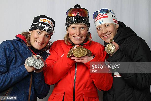 Marie Laure Brunet of France Tora Berger of Norway and Kaisa Maekaeraeinen of Finnland show their medals of the IBU Biathlon World Championships...