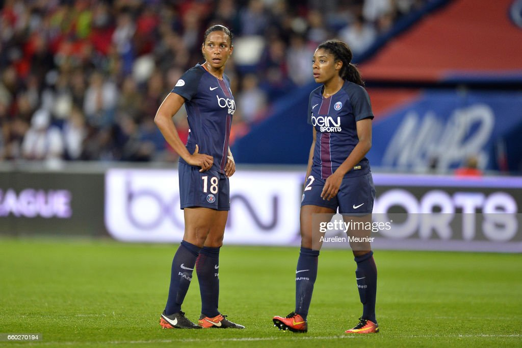 Marie Laure Delie and Ashley Laurence of Paris Saint Germain react during the Champions League match between Paris Saint Germain and Bayern Munich at Parc des Princes on March 29, 2017 in Paris, France.