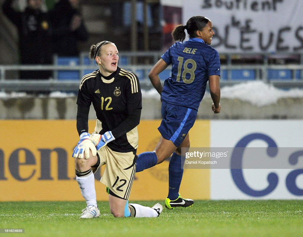 Marie Laure Delie of France (R) celebrates her team's third goal next to <a gi-track='captionPersonalityLinkClicked' href=/galleries/search?phrase=Almuth+Schult&family=editorial&specificpeople=2133917 ng-click='$event.stopPropagation()'>Almuth Schult</a> of Germany during the international friendly match between France and Germany at Stade de la Meinau on February 13, 2013 in Strasbourg, France.