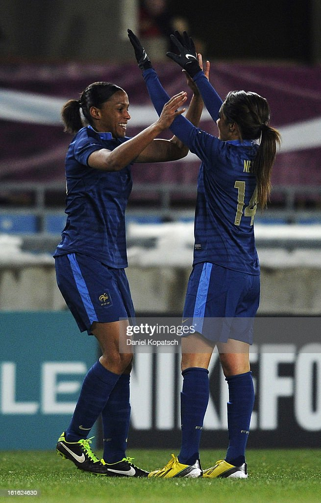 Marie Laure Delie of France (L) celebrates her team's third goal with team mate <a gi-track='captionPersonalityLinkClicked' href=/galleries/search?phrase=Louisa+Necib&family=editorial&specificpeople=2333059 ng-click='$event.stopPropagation()'>Louisa Necib</a> during the international friendly match between France and Germany at Stade de la Meinau on February 13, 2013 in Strasbourg, France.