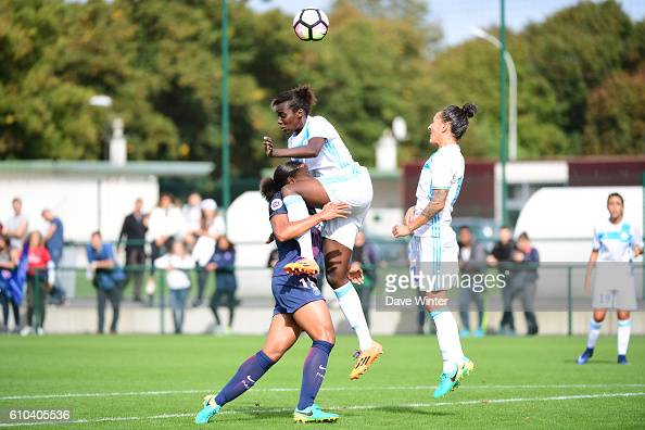 Marie Laure Delie of PSG and Anais MBassidje of Marseille and Kelly Gadea of Marseille during the women's French D1 league match between PSG and...