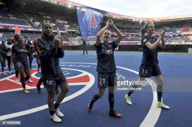 Marie Laure Delie Veronica Boquete and Irene Paredes of Paris SaintGermain salute supporters after the Women's Champions League match between Paris...
