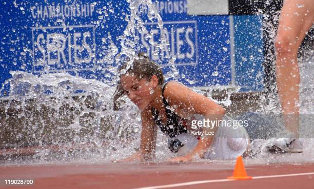 Marie Lawrence of Reno High takes a fall in the water jump in the junior women's steeplechase in the USA Track Field Championships at IUPUI's Mike A...