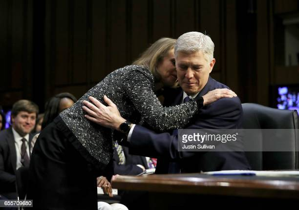 Marie Louise Gorsuch and Judge Neil Gorsuch embrace during the first day of his Supreme Court confirmation hearing before the Senate Judiciary...