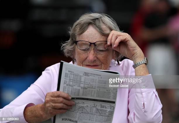 Marie Luleich of Rockport looks over the racing form for the day's races at Suffolk Downs in East Boston on Jul 8 2017 She used to race her horse...
