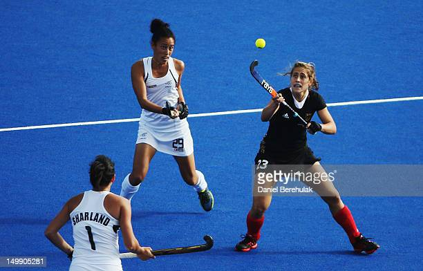 Marie Maevers of Germany and Melody Cooper of New Zealand challenge for the ball during the Women's Hockey match between Germany and New Zealand on...