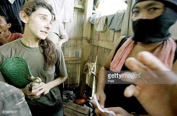 Marie Michel Of Lebanon Left Is Flanked By An Abu Sayyaf Muslim Rebel While Being Detained In A Bamboo Hut At The Rebels' Mountain Camp On Jolo...