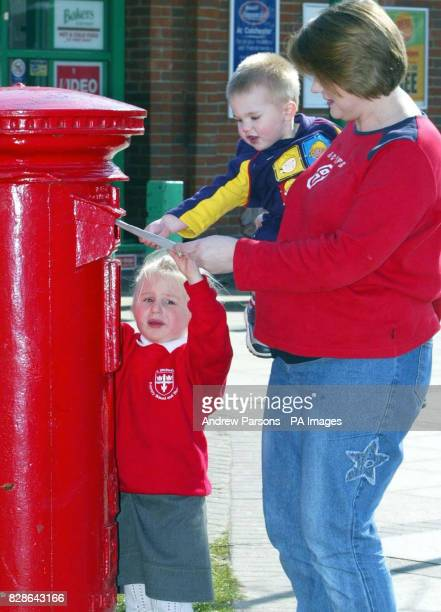 Marie Newton from York her daughter Lauren three and son Matthew one post a letter at a postbox on the garrison base at Colchester Essex to her...
