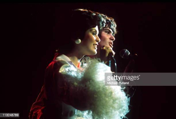 Marie Osmond and Donny Osmond of The Osmonds perform on stage London 1976