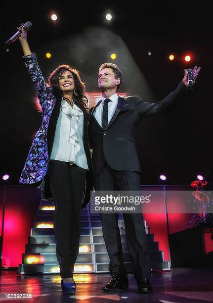 Marie Osmond and Donny Osmond perform on stage at the O2 Arena on January 20 2013 in London England