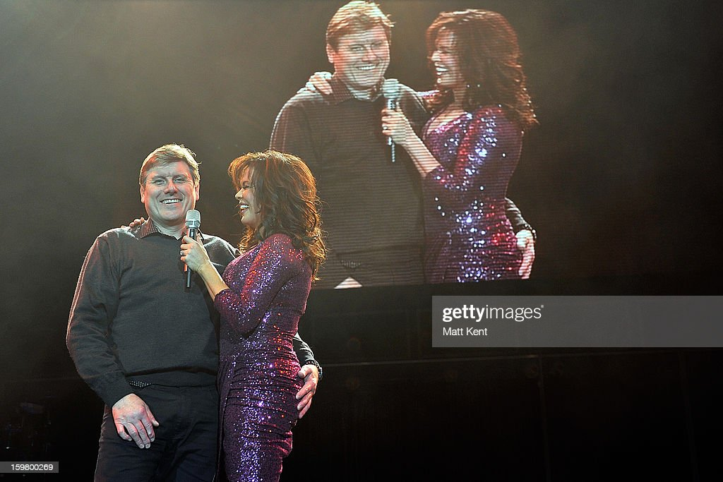 <a gi-track='captionPersonalityLinkClicked' href=/galleries/search?phrase=Marie+Osmond&family=editorial&specificpeople=217477 ng-click='$event.stopPropagation()'>Marie Osmond</a> serenades a member of the audience, who ends up grabbing more than he should, at the Donny and <a gi-track='captionPersonalityLinkClicked' href=/galleries/search?phrase=Marie+Osmond&family=editorial&specificpeople=217477 ng-click='$event.stopPropagation()'>Marie Osmond</a> concert at the 02 Arena on January 20, 2013 in London, England.