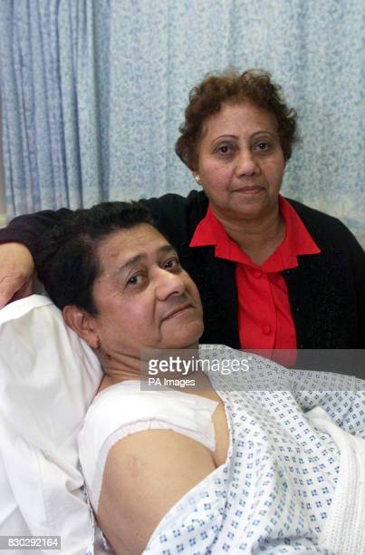 Marie Parcou at the bedside of her husband Jules who was one of the victims of the sword attack at St Andrews' Church in Thornton Heath Surrey Mr...