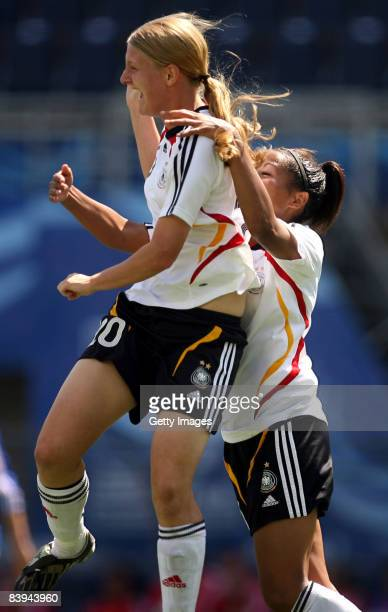 Marie Pollmann and Nicole Banecki of Germany celebrate the first goal during the FIFA U20 Women's World Cup between France U20 and Germany U20 at the...