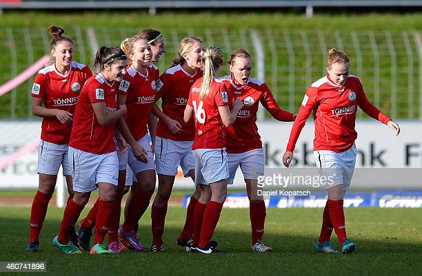 Marie Pollmann of Guetersloh celebrates her team's third goal with team mates during the Women's DFB Cup Quarter Final match between SC Freiburg and...