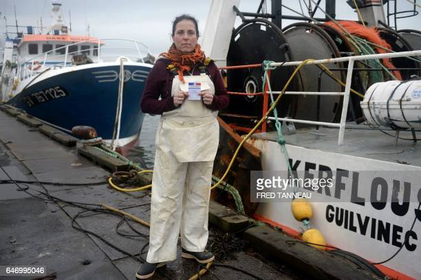 Marie Rouffet a fisherwoman currently training to be a mechanic mother of 4 poses with her voting card on February 7 2017 at the port of Le Guilvinec...