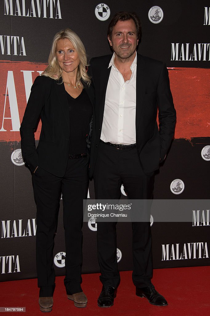 Marie Sarah and Christophe Lambert attend the 'Malavita' premiere at Europacorp Cinema on October 16, 2013 in Roissy-en-France, France.
