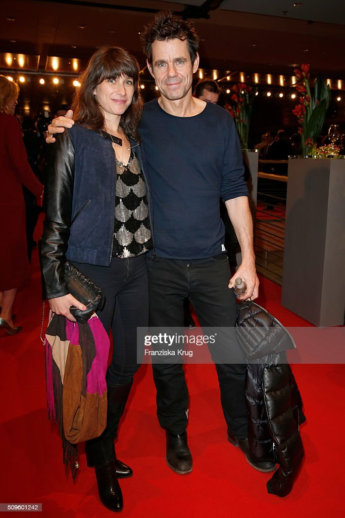 Marie Steinmann and <a gi-track='captionPersonalityLinkClicked' href=/galleries/search?phrase=Tom+Tykwer&family=editorial&specificpeople=768623 ng-click='$event.stopPropagation()'>Tom Tykwer</a> attend the opening party of the 66th Berlinale International Film Festival Berlin at Berlinale Palace on February 11, 2016 in Berlin, Germany.