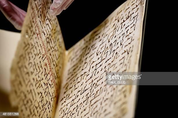 Marie Sviergula conservator of the University of Birmingham holds a Koran mauscript in Birmingham England on July 22 2015 A Koran manuscript has been...