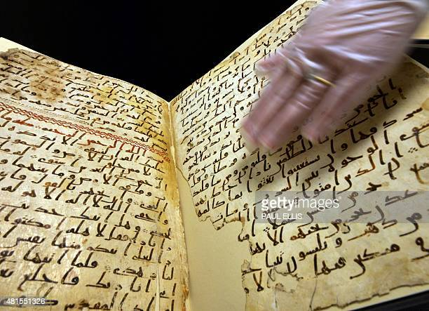 Marie Sviergula conservator of the University of Birmingham holds a Koran mauscript in Birmingham England on July 22 2015 A Koran manuscript has been...
